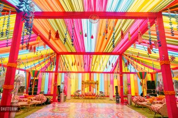 Bright and colorful decor perfect for a mehendi ceremony