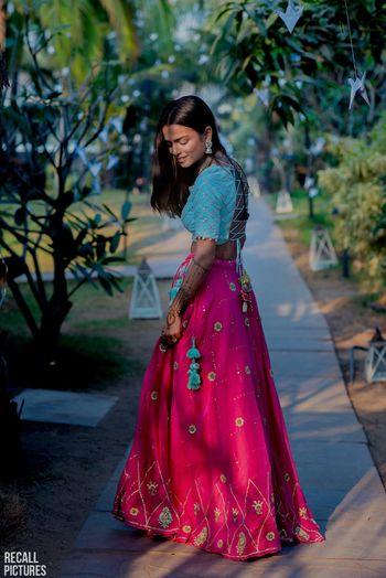Light lehenga for mehendi in turquoise and pink