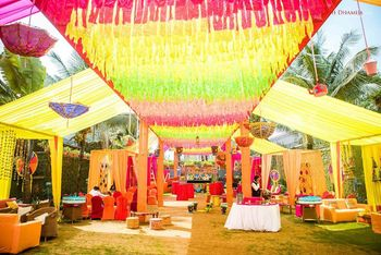 Colourful mehendi tent decor idea with buntings