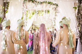 Bride entering under phoolon ki chadar for pastel themed wedding