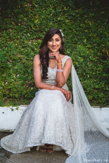 Bride in a shimmery lehenga for sangeet