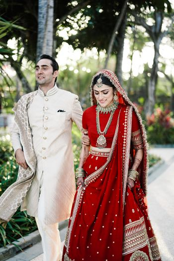 Photo of Bride and groom together, in traditional colours