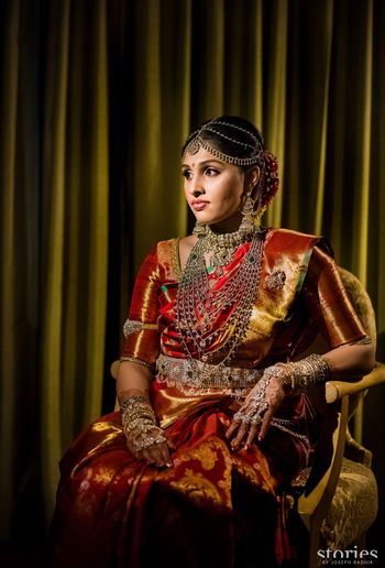 South Indian bridal look in maroon and gold kanjivaram