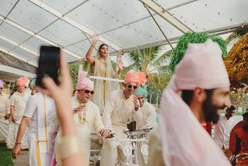 Bride entering with brothers on a rickshaw