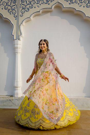 Photo of Bride twirling around on her Mehendi.