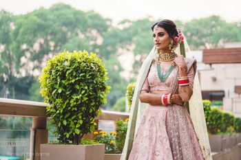 Photo of Light pink lehenga contrasting jewellery