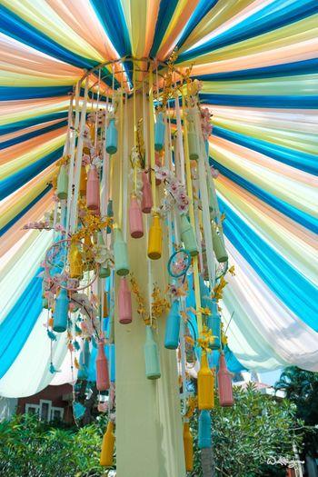 Photo of Mehendi decor idea with painted bottle chandelier