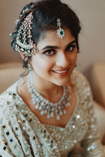 Photo of muslim bride with bridal passa and silver lehenga