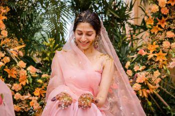 Bride wearing a pastel pink sharara set on her Haldi.