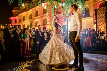 Photo of Bride and groom performing first dance.