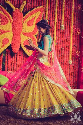 bright colorblocked lehenga in leheriya yellow pink and blue with mirror work detailing