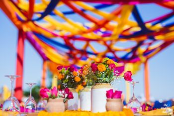 Photo of colourful mehendi decor idea with pickle jars
