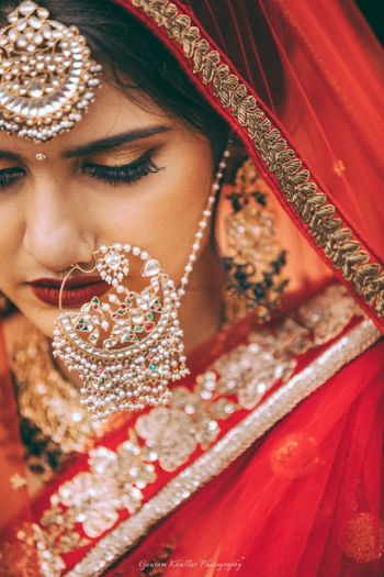 Photo of Oversized bridal nosering with matching maangtikka