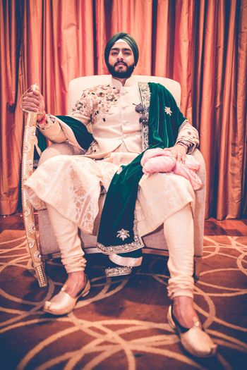 Groom Wedding Dresses Photo emerald green stole on groom on gold and beige self sherwani