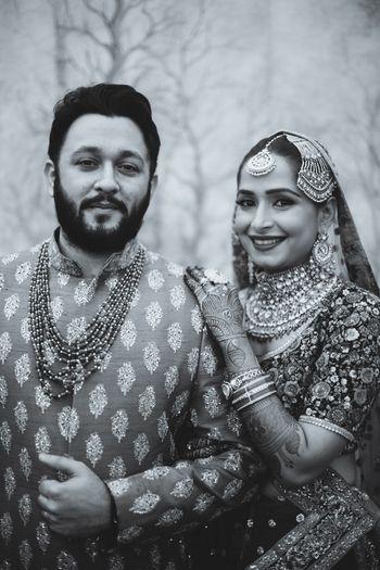 Black and white royal bridal couple indian