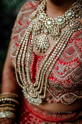 A layered raani haar with statement pendant