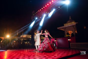 Photo of Couple dancing on stage after the wedding