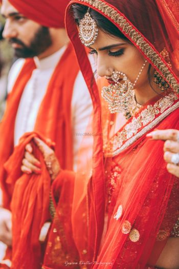 Bridal portrait with bride wearing oversized Nath
