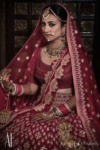 Photo of Royal bridal portrait with maroon lehenga