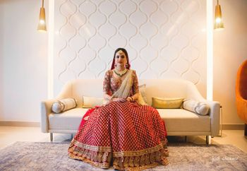Pretty bride wearing red and golden lehenga