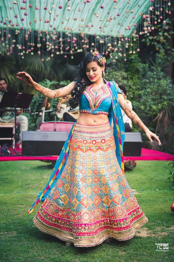 Photo of Bright mehendi lehenga quirky