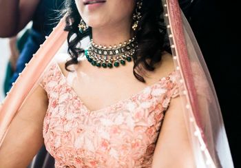 Bride wearing emerald green choker necklace
