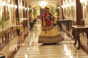 gold brocade bridal lehenga with a teal blouse and red dupatta