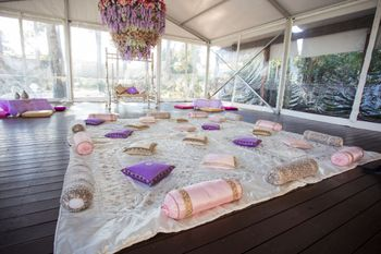 A sit-down Mehendi setup for guests.