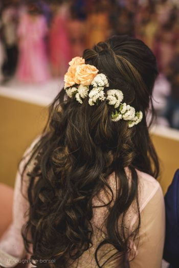 Engagement hairstyle with flowers in hair