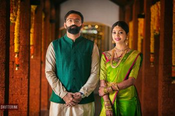 Photo of Coordinated South Indian bride and groom in green