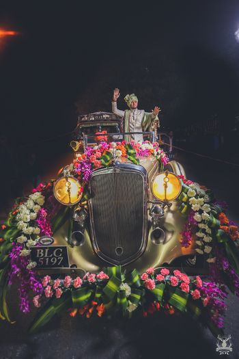 Photo of Groom entering in decked up vintage car