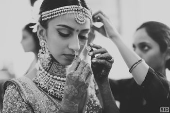 Bride adjusting nath