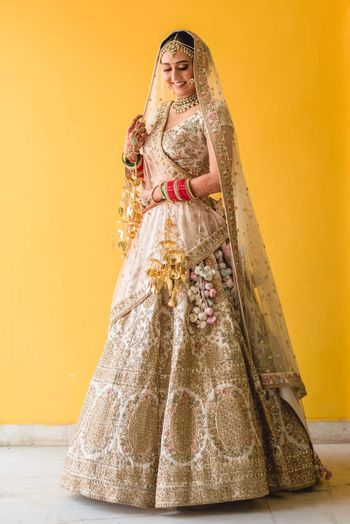White and gold bridal lehenga with double dupatta