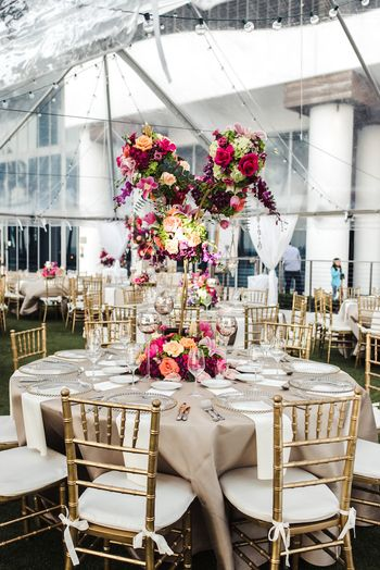 Gold table setting with giant floral centrepiece