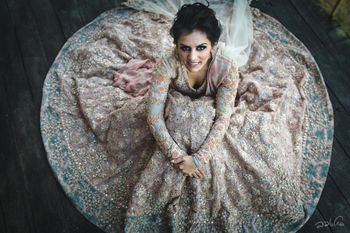 Photo of Bridal portrait idea with Sabyasachi lehenga flared out