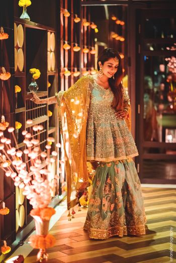 A gorgeous sharara in offbeat hues the bride wore for her dhol night