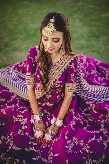 Photo of Aubergine Sabyasachi lehenga