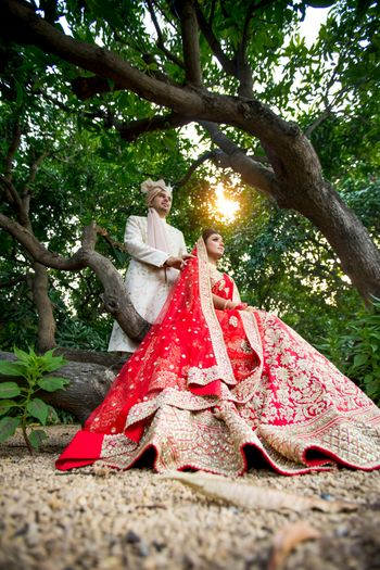 Unique couple shot with the bride in a red lehenga