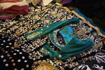 blue velvet lehenga for sangeet with white and gold embroidery
