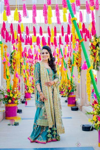 mehendi bridal look and happy tassel decor idea