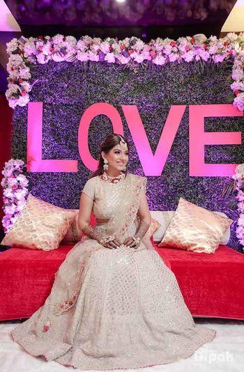 Bride in beige for mehendi
