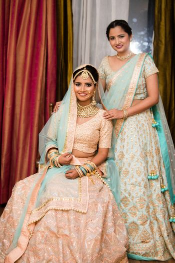 Bride and sister both in pastels