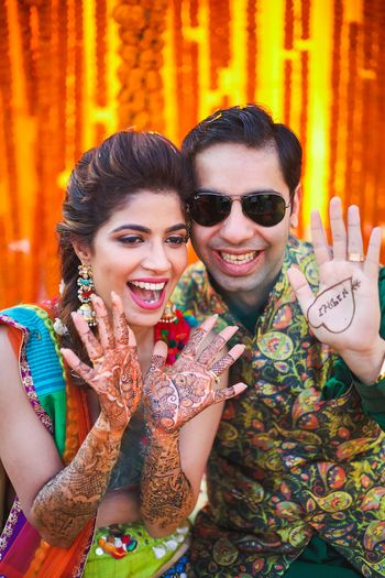 Cute bride and groom mehendi
