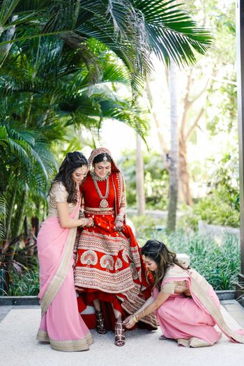 Photo of Bridesmaids helping the bride get ready