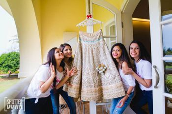 Getting ready shots with bridesmaids and lehenga