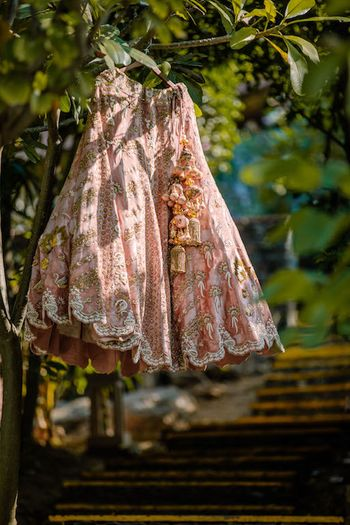 Offbeat dusty peach lehenga on hanger