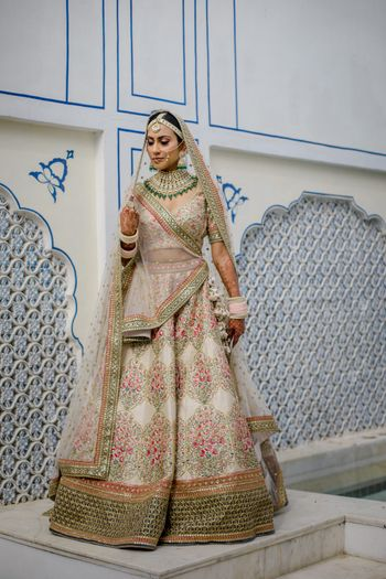 Bride wearing ivory lehenga on her wedding.
