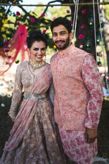 Photo of Bride in Sabyasachi with floral dupatta and waist belt