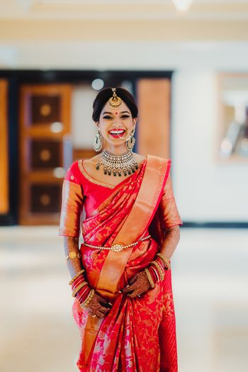 A bride in red kanjeevaram on her wedding day
