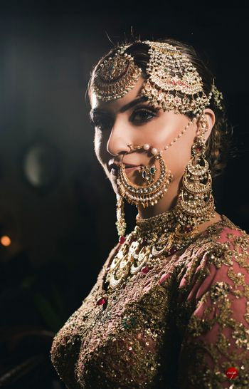 A close-up shot of bride in vintage jewels